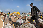 13 february 2013 - Dandora dumpsite, Nairobi, Kenya - Young Kenyans take a break from scavenging for recyclable materials at the Dandora dumpsite, one of the largest and most toxic in Africa. Located near slums in the east of the Kenyan capital Nairobi, the open dump site was created in 1975 and covers 30 acres. The site receives 2,000 tonnes of unfiltered garbage daily, including hazardous chemical and hospital wastes. It is a source of survival for many people living in the surrounding slums, however it also harms children and adults' health in the area and pollutes the Kenyan capital. Photo credit: Benedicte Desrus