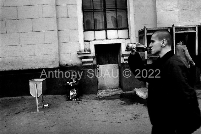 Moscow, Russia  .1998.A pensioner on the edge of survival at the Leningradsky train station in central Moscow..