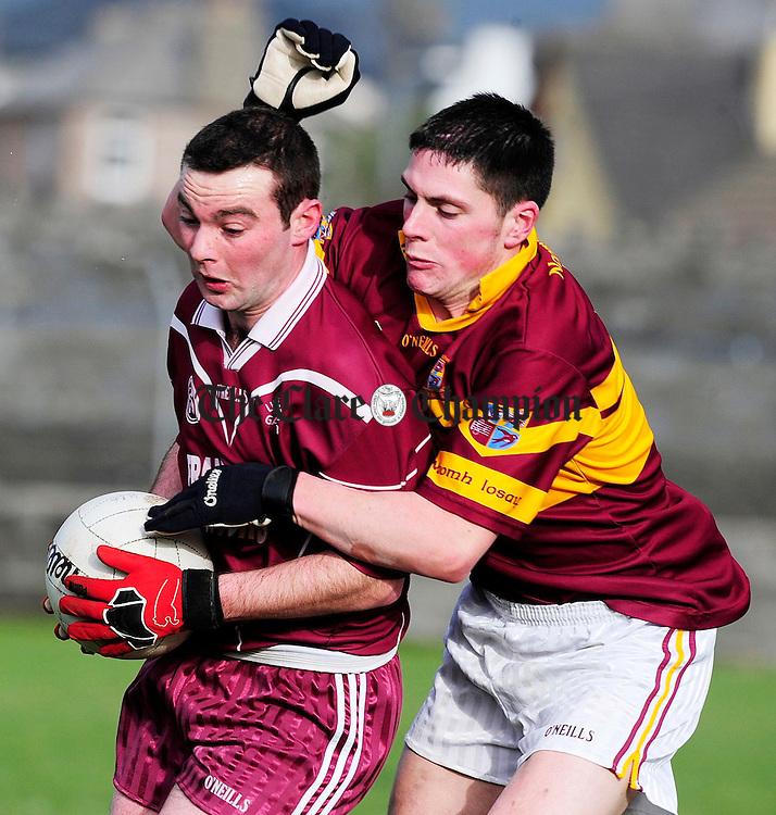 Lissycaseys Alan Nagle battles with Miltowns Graham Kelly.Pic Arthur Ellis.