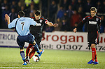 Lee McCulloch's free-kick is charged down by Omar Kader