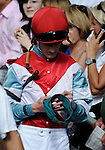 11 February 05: Jockey Julien Leparoux signs an autograph in the paddock at Gulfstream Park in Hallandale Beach, Florida on Donn Handicap Day.  (Bob Mayberger/Eclipse Sportswire)