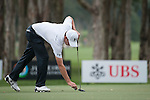 Matthew Fitzpatrick of England replaces his ball during Hong Kong Open golf tournament at the Fanling golf course on 25 October 2015 in Hong Kong, China. Photo by Xaume Olleros / Power Sport Images
