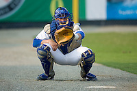 Catcher Josh Vittek (36) of the Burlington Royals warms-up the starting pitcher in the bullpen at Burlington Athletic Park in Burlington, NC, Saturday, July 26, 2008. (Photo by Brian Westerholt / Four Seam Images)