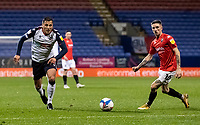 Bolton Wanderers' Antoni Sarcevic (left) breaks away from Salford City's Ashley Hunter<br /> <br /> Photographer Andrew Kearns/CameraSport<br /> <br /> The EFL Sky Bet League Two - Bolton Wanderers v Salford City - Friday 13th November 2020 - University of Bolton Stadium - Bolton<br /> <br /> World Copyright © 2020 CameraSport. All rights reserved. 43 Linden Ave. Countesthorpe. Leicester. England. LE8 5PG - Tel: +44 (0) 116 277 4147 - admin@camerasport.com - www.camerasport.com