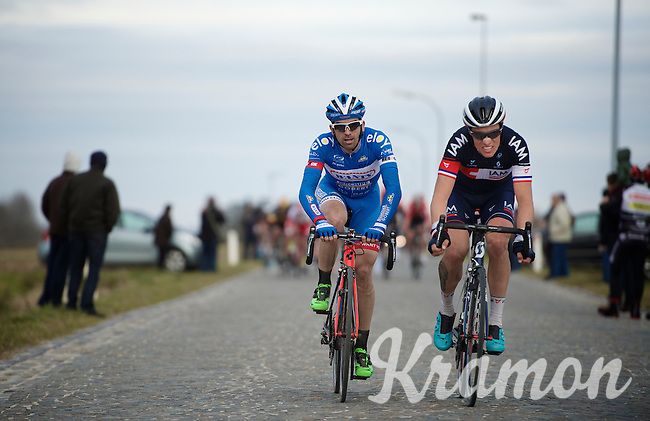 Marco Marcato (ITA/Wanty-Groupe Gobert) & Sylvain Chavanel (FRA/IAM) almost caught by the peloton on the Lange Munte pavé<br /> <br /> Omloop Het Nieuwsblad 2015