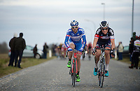 Marco Marcato (ITA/Wanty-Groupe Gobert) & Sylvain Chavanel (FRA/IAM) almost caught by the peloton on the Lange Munte pavé<br /> <br /> Omloop Het Nieuwsblad 2015