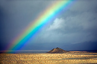 Small cinder cone and rainbow. Black Rock Desert National Conservation Area. Nevada
