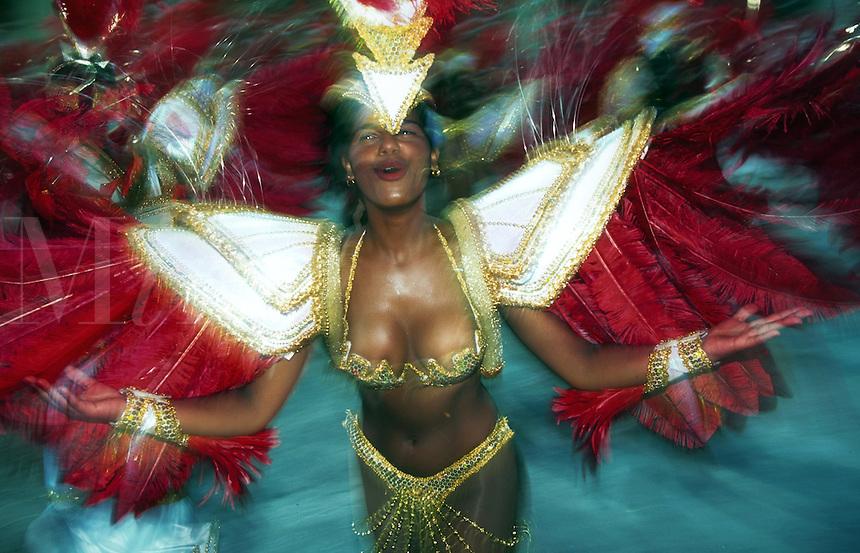 Blurred motion image of a female Carnivale dancer in an ornate costume. Rio De Janeiro.