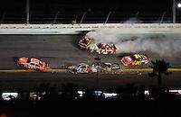 Feb 07, 2009; Daytona Beach, FL, USA; NASCAR Sprint Cup Series drivers Joey Logano (20) Scott Speed (82) David Ragan (6) Robby Gordon (7) and Casey Mears (07) crash as Jeff Gordon (24) slows to avoid during the Bud Shootout at Daytona International Speedway. Mandatory Credit: Mark J. Rebilas-