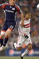 New England Revolution midfielder/defender Jeff Larentowicz (13) and Chicago Fire midfielder Mike Banner (18) battle for head ball. The New England Revolution tied the Chicago Fire, 0-0, at Gillette Stadium on October 17, 2009.
