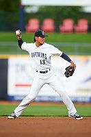 Lake County Captains shortstop Yu-Cheng Chang (13) throws to first during a game against the Fort Wayne TinCaps on May 20, 2015 at Classic Park in Eastlake, Ohio.  Lake County defeated Fort Wayne 4-3.  (Mike Janes/Four Seam Images)