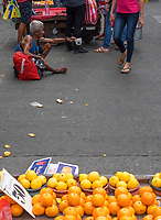 A beggar on the street near China Town. Manila, Philippines