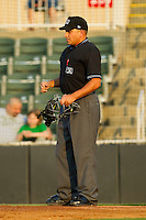 Home plate umpire Jose Esteras during the South Atlantic League game between the Delmarva Shorebirds and the Kannapolis Intimidators at Fieldcrest Cannon Stadium on May 21, 2011 in Kannapolis, North Carolina.   Photo by Brian Westerholt / Four Seam Images