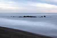 Rocks in cambria under a grey sky