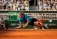 Paris, France, 2 june, 2019, Tennis, French Open, Roland Garros, Stefanos Tsitsipas (GRE) takes a dive in his match against Wawrinka (SUI)<br /> Photo: Henk Koster/tennisimages.com