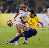 USWNT midfielder (9) Heather O'Reilly has the ball cleared away from her by  Brazilian forward (11) Cristiane while playing for the gold medal at Workers' Stadium.  The USWNT defeated Brazil, 1-0, during the 2008 Beijing Olympic final in Beijing, China.