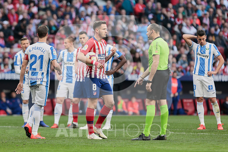 Atletico de Madrid's Saul Niguez have words with the referee during La Liga match between Atletico de Madrid and CD Leganes at Wanda Metropolitano stadium in Madrid, Spain. March 09, 2019. (ALTERPHOTOS/A. Perez Meca)