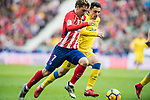 Antoine Griezmann (L) of Atletico de Madrid is tackled by Joaquin Navarro Jimenez, Ximo, of UD Las Palmas during the La Liga 2017-18 match between Atletico de Madrid and UD Las Palmas at Wanda Metropolitano on January 28 2018 in Madrid, Spain. Photo by Diego Souto / Power Sport Images