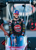 Nov 1, 2020; Las Vegas, Nevada, USA; NHRA top alcohol dragster driver Megan Meyer-Lingner celebrates after winning the NHRA Finals and the 2020 top alcohol dragster world championship at The Strip at Las Vegas Motor Speedway. Mandatory Credit: Mark J. Rebilas-USA TODAY Sports