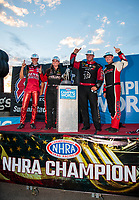 Nov 1, 2020; Las Vegas, Nevada, USA; NHRA champions (from left) pro stock motorcycle rider Matt Smith, pro stock driver Erica Enders, funny car driver Matt Hagan and top fuel driver Steve Torrence celebrate after winning the NHRA Finals and the 2020 pro stock World Championship at The Strip at Las Vegas Motor Speedway. Mandatory Credit: Mark J. Rebilas-USA TODAY Sports