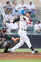 Trey Michalczewski (27) of the Kannapolis Intimidators follows through on his swing against the Savannah Sand Gnats at CMC-Northeast Stadium on June 9, 2014 in Kannapolis, North Carolina.  The Intimidators defeated the Sand Gnats 4-2.  (Brian Westerholt/Four Seam Images)