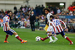 Atletico de Madrid's Arda Turan and Juanfran and Real Madrid´s Marcelo Vieira during quarterfinal first leg Champions League soccer match at Vicente Calderon stadium in Madrid, Spain. April 14, 2015. (ALTERPHOTOS/Victor Blanco)
