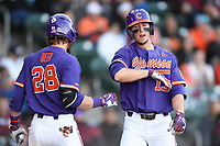 Left fielder Drew Wharton (13) of the Clemson Tigers shouts as he celebrates scoring the Tigers' fifth run in the Reedy River Rivalry game against the South Carolina Gamecocks on Saturday, March 3, 2018, at Fluor Field at the West End in Greenville, South Carolina. Clemson won, 5-1. (Tom Priddy/Four Seam Images)
