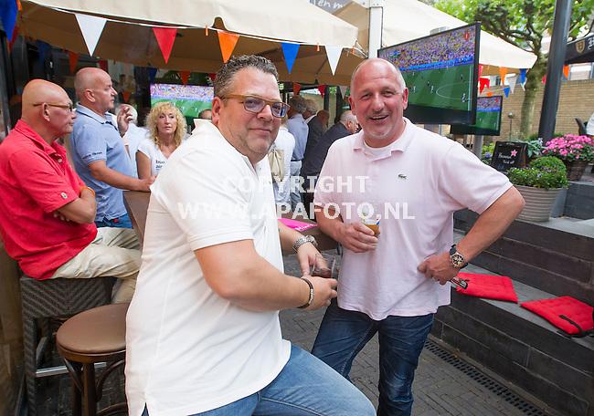 OOSTERBEEK 040714 Uitbater Hans Monster en eigenaar Rick Paauw op het terras van cafe Mimi's in Oosterbeek. Na elven mag er buiten geen voetbal gekeken worden.<br /> Foto Jorrit Knuvelder - APA Foto