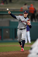 Pitcher Josh O'Neill (33) of the Stony Brook Seawolves throws to first in a game against the Clemson Tigers on Friday, February 21, 2020, at Doug Kingsmore Stadium in Clemson, South Carolina. Clemson won, 2-0. (Tom Priddy/Four Seam Images)