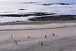 St Ouens Bay Jersey The Channel islands UK. Families walking on the beach 2000s