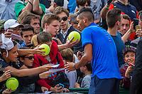 Paris, France, 25 June, 2016, Tennis, Roland Garros, Nick Kyrgios (AUS) signs autographs after  his match against Igor Sijsling (NED)<br /> Photo: Henk Koster/tennisimages.com