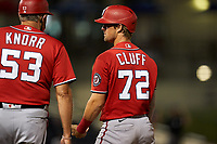 Washington Nationals Jackson Cluff (72) talks with first base coach Randy Knorr (53) during a Major League Spring Training game against the Houston Astros on March 19, 2021 at The Ballpark of the Palm Beaches in Palm Beach, Florida.  (Mike Janes/Four Seam Images)