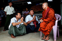 U Wirathu, the spiritual leader of the Buddhist nationalist 969 Movement, talks with supporters after a service in which he gave awards to young students at the Aye Thaka Monastery in Mandalay. U Wirathu is an abbot in the New Maesoeyin Monastery where he leads about 60 monks and has influence over more than 2,500 residing there. He travels the country giving sermons to religious and laypeople encouraging Buddhists to shun Muslim business and communities. /Felix Features