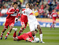 New York Red Bulls midfielder Macoumba Kandji (10) is fouled by Chicago Fire midfielder John Thorrington (11).  Thorrington received a red card on the play.  The Chicago Fire defeated the New York Red Bulls 1-0 at Toyota Park in Bridgeview, IL on April 5, 2009. Photo by Tracy Allen / isiphotos.com