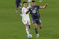 ST PAUL, MN - OCTOBER 28: Cole Bassett #26 of Colorado Rapids  and Michael Boxall #15 of Minnesota United FC battle for the ball during a game between Colorado Rapids and Minnesota United FC at Allianz Field on October 28, 2020 in St Paul, Minnesota.