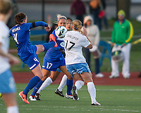 Boston Breakers defender Cat Whitehill (4) kicks a high ball  as Boston Breakers forward Kyah Simon (17) and Chicago Red Stars midfielder/forward Lori Chalupny (17) converge on the ball.  In a National Women's Soccer League Elite (NWSL) match, the Boston Breakers defeated  Chicago Red Stars 4-1, at the Dilboy Stadium on May 4, 2013.