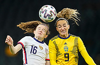 SOLNA, SWEDEN - APRIL 10: Rose Lavelle #16 of the United States heads a ball during a game between Sweden and USWNT at Friends Arena on April 10, 2021 in Solna, Sweden.
