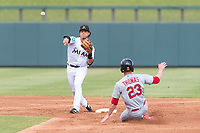 Salt River Rafters shortstop Bryson Brigman (15), of the Miami Marlins organization, throws to first base to try to complete a double play as Lane Thomas (23) slides into second base during an Arizona Fall League game against the Surprise Saguaros at Salt River Fields at Talking Stick on October 23, 2018 in Scottsdale, Arizona. Salt River defeated Surprise 7-5 . (Zachary Lucy/Four Seam Images)