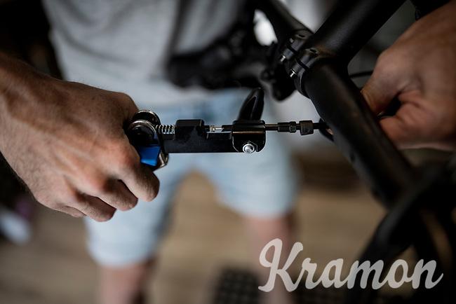 Belgian top custom bike mechanic Vince Van Parijs of Peloton de Paris (Mechelen) assembles a custom Ridley Kanzo gravel bike > working with a hydraulic cable tool here<br /> <br /> ©kramon