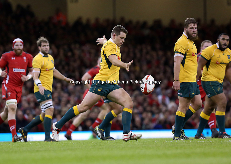 Pictured: Nick Phipps of Australia kicking the ball forward. Saturday 08 November 2014<br /> Re: Dove Men Series rugby, Wales v Australia at the Millennium Stadium, Cardiff, south Wales, UK.
