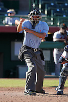 Home plate umpire Chris Segal during an Arizona Fall League game between the Scottsdale Scorpions and Surprise Saguaros at Scottsdale Stadium on October 31, 2011 in Scottsdale, Arizona.  Surprise defeated Scottsdale 8-5.  (Mike Janes/Four Seam Images)