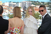 Bella Heathcote Elle Fanning Nicolas Winding Refn attends 'The Neon Demon' Photocall durig The 69th Annual Cannes Film Festival on May 20, 2016 in Cannes