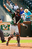 Augusta GreenJackets catcher Trevor Brown (41) makes a throw to first base against the Greensboro Grasshoppers at NewBridge Bank Park on August 11, 2013 in Greensboro, North Carolina.  The GreenJackets defeated the Grasshoppers 6-5 in game one of a double-header.  (Brian Westerholt/Four Seam Images)