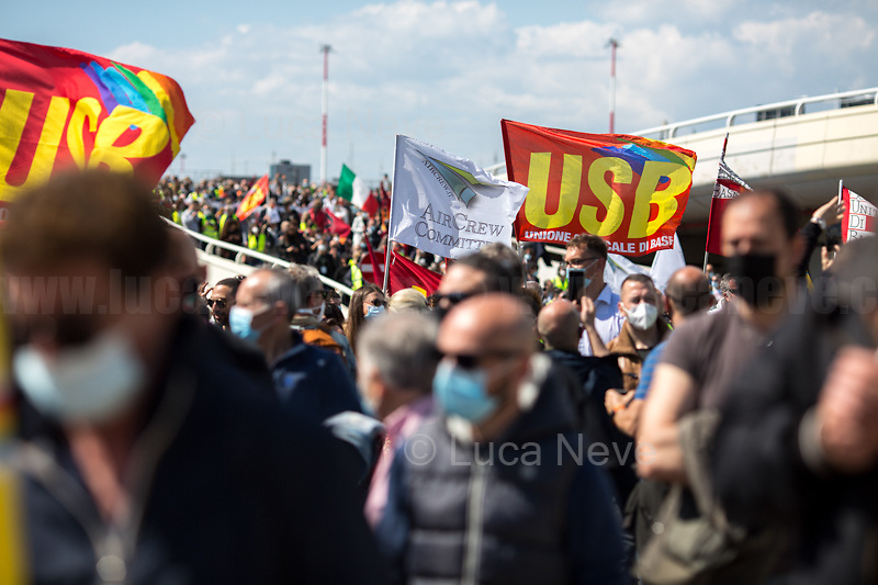 Rome, Italy. 23rd Apr, 2021. Today, Alitalia, air transport, Airports, logistic, and related workers, led by USB, CUB Trasporti Trade Unions, and supported by the Mayor of Fiumicino, held a protest outside the Terminal 3 of Rome's Fiumicino Airport (main Rome's Airport also known as Leonardo Da Vinci Airport). The aims of the demo were to protest against the plan, under discussion between Mario Draghi's Italian Government and the European Union (EU - UE), to dismantle the flag carrier of Italy, Alitalia, make it a small and regional airline with a different name - while it is still one of the biggest airport slots owner in the world -, and to lay-off the majority of the workers - about 11,000 - of the Italian historical air company. At the end of the demo protesters, patrolled by a conspicuous number of police officers, were allowed to demonstrate outside the Alitalia HQ near the airport.   <br /> <br /> Footnotes & Links:<br /> Previous Demo:<br /> 16.04.2021 - Alitalia Workers Protest At Fori Imperiali and Campidoglio https://lucaneve.photoshelter.com/gallery/16-04-2021-Alitalia-Workers-Protest-At-Fori-Imperiali-and-Campidoglio/G0000unf5F2yc0Ts/C0000GPpTqAGd2Gg<br /> 03.03.2021 - Alitalia Workers Protest Outside Italian Ministry Of Transport https://lucaneve.photoshelter.com/gallery/03-03-2021-Alitalia-Workers-Protest-Outside-Italian-Ministry-Of-Transport/G0000JI_TNBKDjz8/C0000GPpTqAGd2Gg