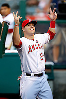 Mike Trout #27 of the Los Angeles Angels in the Angels dugout before a game against the St. Louis Cardinals at Angel Stadium on July 3, 2013 in Anaheim, California. (Larry Goren/Four Seam Images)