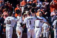 Oregon State Beavers Alex McGarry (44) is congratulated by Ryan Ober (18), Micah McDowell (12), and Kyler McMahan (1) after hitting a home run during an NCAA game against the New Mexico Lobos at Surprise Stadium on February 14, 2020 in Surprise, Arizona. (Zachary Lucy / Four Seam Images)