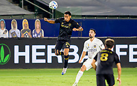 CARSON, CA - SEPTEMBER 06: Andy Najar #24 of LAFC heads a ball during a game between Los Angeles FC and Los Angeles Galaxy at Dignity Health Sports Park on September 06, 2020 in Carson, California.
