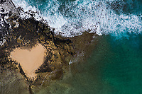 An aerial view of a heart-shaped spot of sand in Po'ipu Beach Park, Kaua'i.