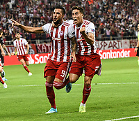 Olympiakos's Guerrero with his team player Tsimikas celebrates his goal during the UEFA Champions League playoff first leg soccer match between Olympiakos and Krasnodar at Karaiskaki stadium in Piraeus, Greece, on 21 August 2019