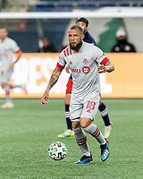 FOXBOROUGH, MA - OCTOBER 7: Nick DeLeon #18 of Toronto FC passes the ball during a game between Toronto FC and New England Revolution at Gillette Stadium on October 7, 2020 in Foxborough, Massachusetts.